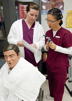 Medical assisting student uses professional equipment