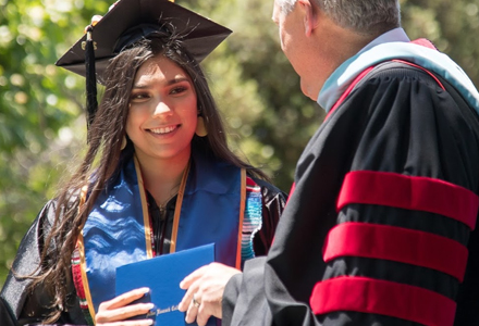 Woman graduating holding diploma