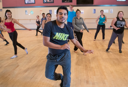 Dance instructor leading a group