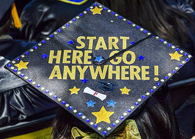 Graduation Cap decorated with Start Here. Go Anywhere.